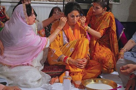 Bride goes through ceremony called Chura and Maiya