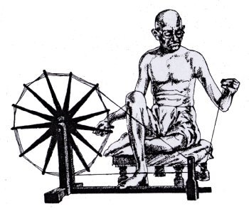 Gandhiji with his spinning wheel.