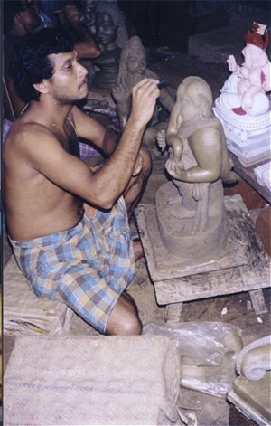 Artist Making Idol of Ganesh