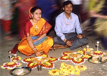 Newly Weds Offering Prayers with Flowers