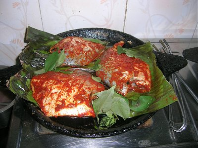 Pomfret Fish being Fried on a Stone Pan