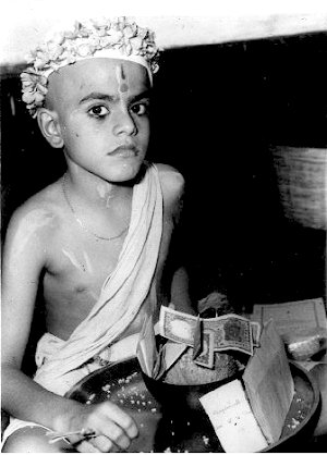 A Brahmin Vatu (student)  begs his first meal