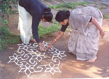Mother Teaches Kolam to Daughter