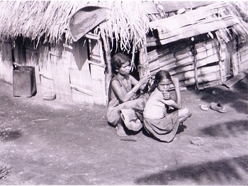 Tribal Women in front of their Hut
