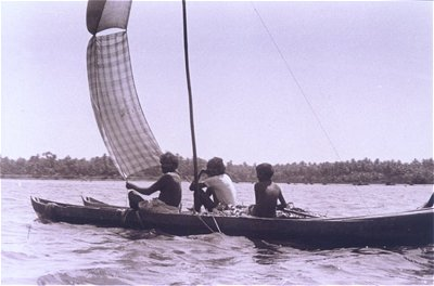 Fishermen Using Lungi as Sail
