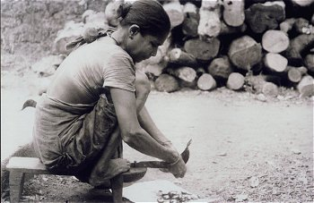 Woman Operates a Addoli (Stationary Knife)