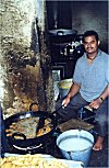 Man Frying Fritters