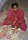 Girl Making Garlands for Sale