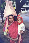 Woman Balancing Child and Errands