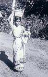 Woman Balancing Basket and Child