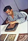 Artist Carving a Relief