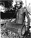 A  drummer of the Santhal tribe, West Bengal