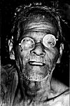 Halakki Tribal man in broken eye glasses