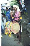 A drummer with drum in procession