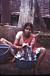 Woman Handwashing Clothes