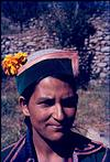 A Himalayan young lady with a flower in her cap