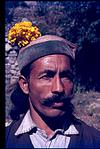 A villager from himachal Pradesh with flower