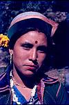 A kinari woman with flower in cap and in bindi