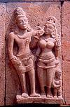 Couple in stone with dwarf