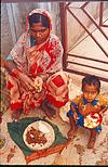 A young builder at her curdle meal of rotis and vegetables.