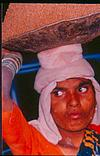 A woman laborer carrying sand