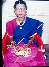 A well dressed girl with showing her ornaments