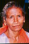 A elderly woman of laboring class