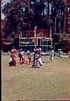 A garden scene with Visitors, 1964