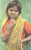 A young girl in an adult sari