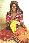 A Lambani lady embroidering a piece of yellow cloth