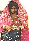 A Banjara (Gypsy) woman, lost in the intricate world of  Kasooti (needle craft)