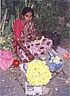 A housewife selling flowers for extra earnings.