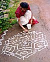 Even a college girl takes rangoli very seriously.