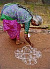 Picture of Woman Laying Rangoli
