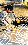 She commenced her rangoli early in the morning.