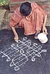 Her expert hands draw a rangoli in no time!