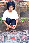 This gal spreads the special Pongal rangoli.