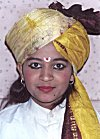 A young woman looks very charming in a turban.