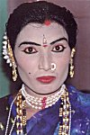 A Man Elaborately Dresses as a Woman for a Play
