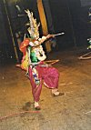 Chhau Dancer Shooting an Arrow During Performance