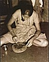 Konkani Woman in Preparation of a Special Paste