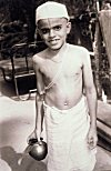 Hindu Boy with Sacred Thread Carrying Water