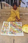 Illiterate Sells Alphabets