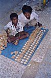 Boys Selling Oil Lamps for Deepavali