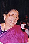 Jyotsna Speaking at a History Convention, 1995