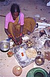 A construction worker preparing dinner on the street