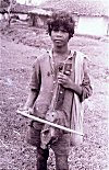 Boy Begging with a Country Musical Instrument