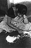 Indian Woman Cleaning Rice