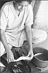 Girl Cleaning Scales of a Fish