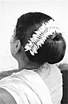 Jasmin Flowers on a Woman's Hair-Bun